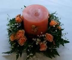 Arreglo floral con vela